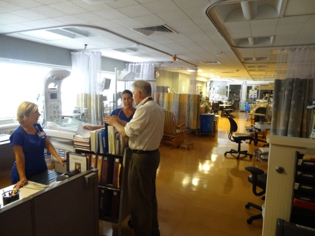 Dr. McNamara speaking with two nurses in the Dominican Hospital NICU