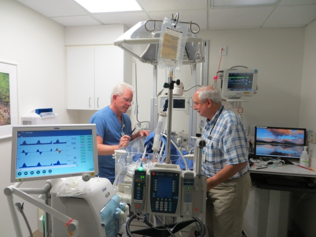 Drs. Greg Glasscock and Carl Yaeger at the beside in the Salinas NICU.